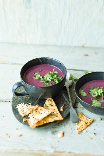 Red cabbage and coconut soup with mint and sesame seed crisps