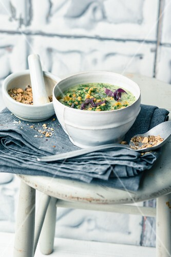 Kale and coconut soup with apricots and peanut and coconut sprinkles