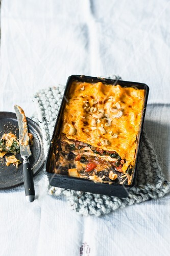 Vegetarian and chard curry lasagne with cherries and cashew nuts