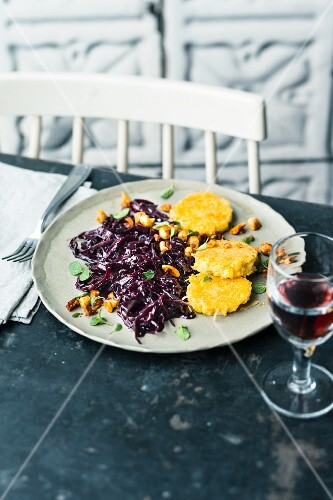 Polenta cakes with elderberry and red cabbage salad and Thai curry paste
