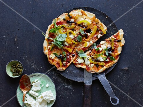 An antipasti peppers, capers and sheep's cheese pizza
