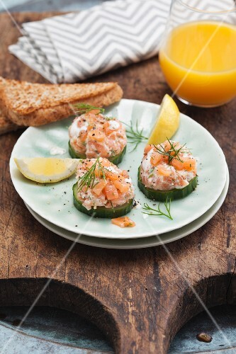 Cucumber bites topped with salmon and cream cheese tartare