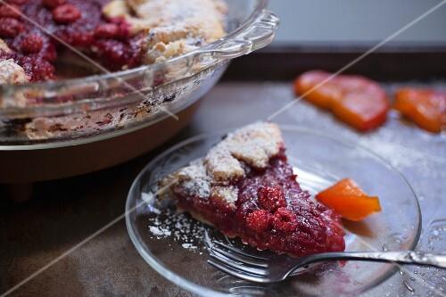 Rustic wild raspberry and persimmon tart, sliced