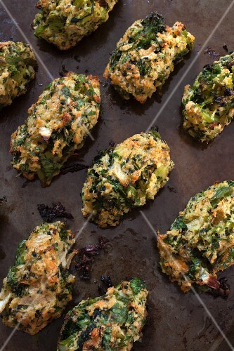 Baked broccoli bites on a baking tray