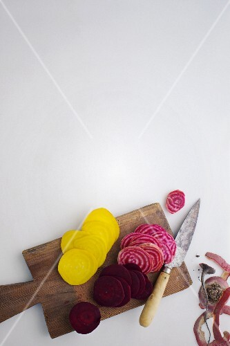 Colourful sliced beetroot on a light surface