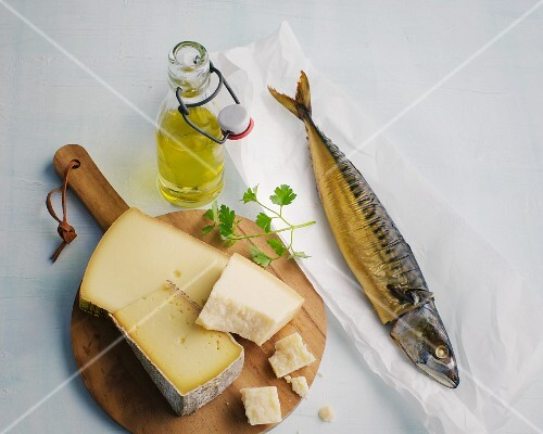A bottle of oil, mackerel and cheese
