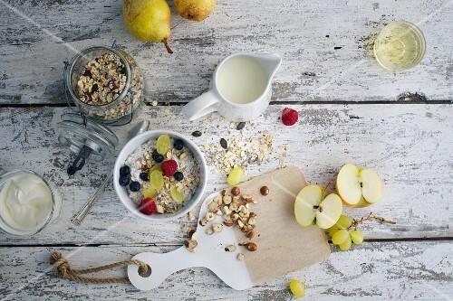 Muesli with fruit, yoghurt and milk for breakfast
