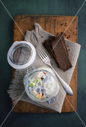 A soused herring salad in a jar