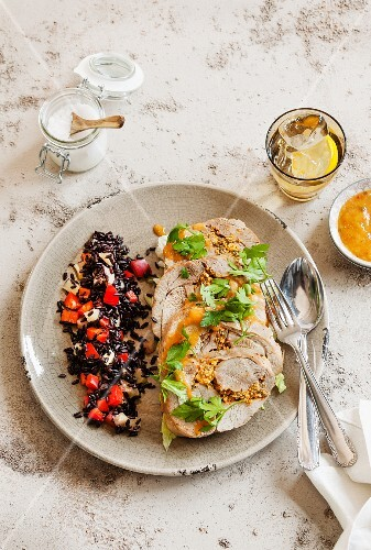 Stuffed turkey roulade with a side of black rice