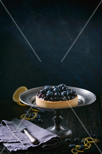 Blueberry and lemon tartlet on a cake stand