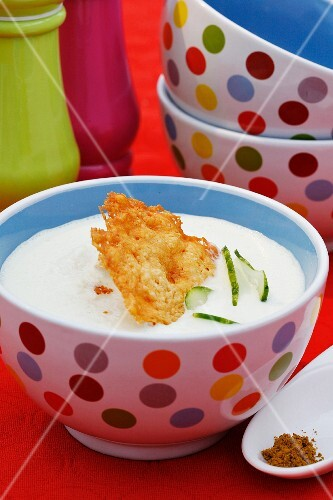 Cold cucumber and yoghurt soup with a Parmesan wafer