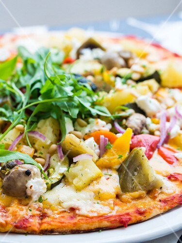 Vegetarian pizza with vegetables and rocket