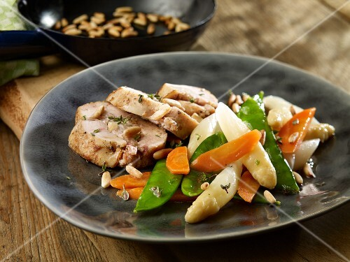 Chicken breast with pine nuts and spring vegetables