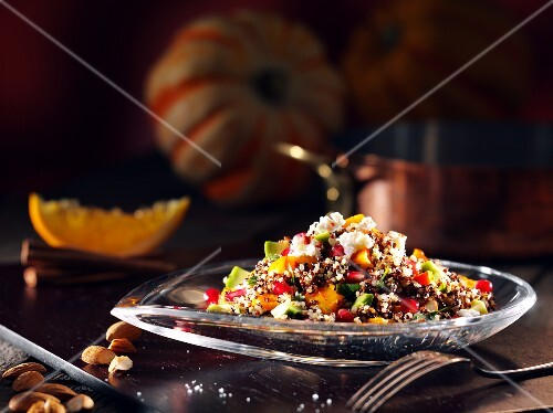 Quinoa with pumpkin and vegetables in a glass dish
