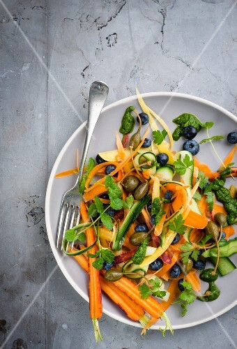 Carrot and courgette salad with blueberries and capers