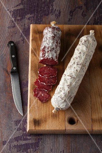 Air-dried salami on a wooden board
