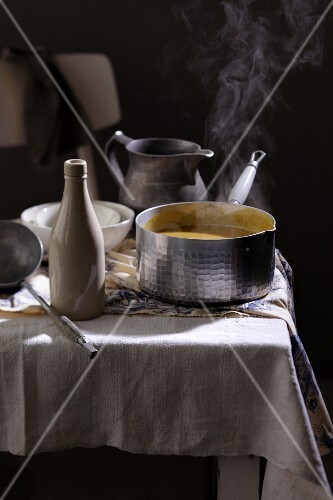 Steaming soup on a laid table