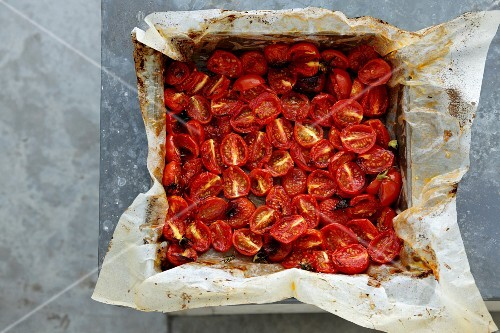 Oven-roasted cherry tomatoes on a baking tray