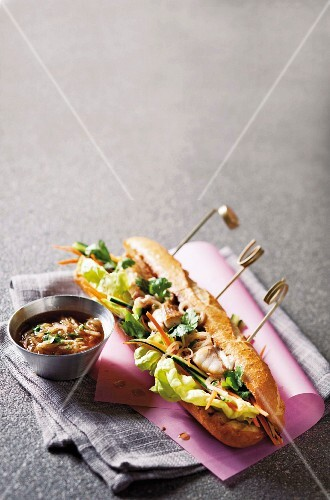 Vietnamese fish rolls with shallots and coriander vinaigrette in a baguette