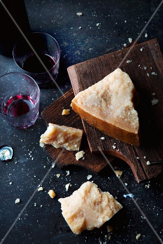 An arrangement of Parmesan cheese and red wine