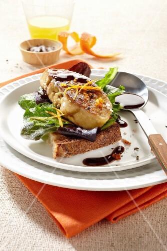 Fried foie gras with orange zest on grilled bread