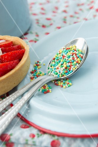 Colourful sugar sprinkles on a silver spoon