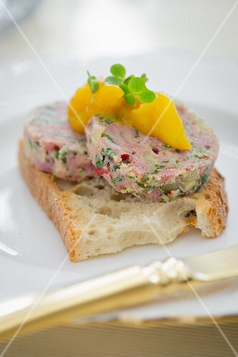 Bread topped with meat pâté for Christmas