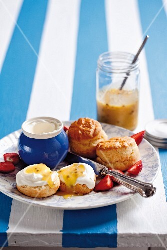 Scones with clotted cream and passion fruit curd (England)