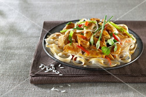 Thai-style chicken on a bed of rice noodles