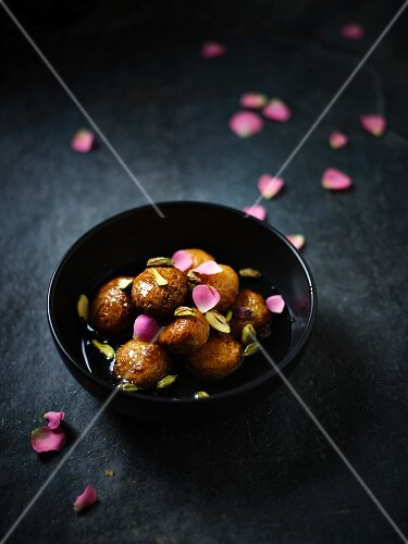 Gulab Jamun (Indian pastry balls) with pistachios and rose syrup