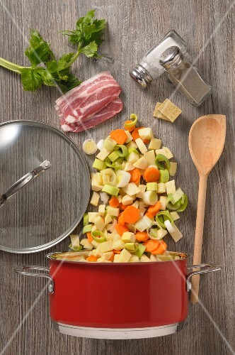 Ingredients of vegetable soup with bacon (seen from above)