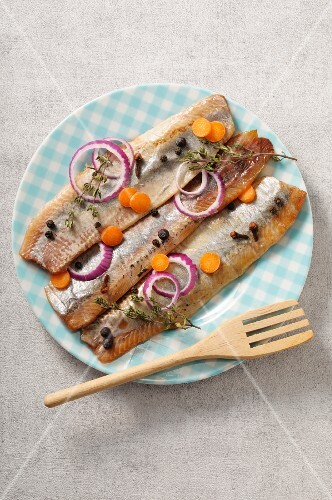 Pickled herring fillets with spices, onions and carrots