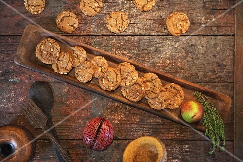 Ginger snap biscuits on a rustic wooden table