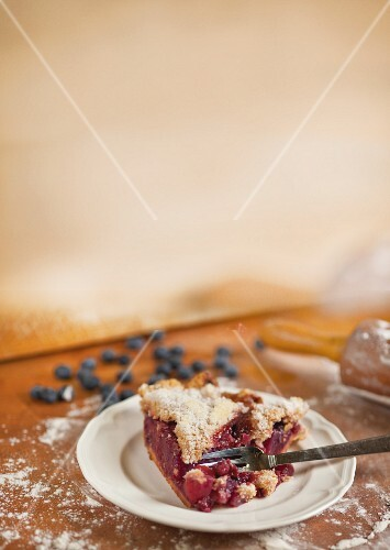 A slice of berry cake with apple