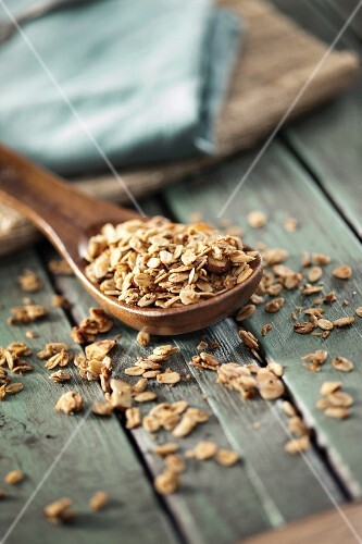 Granola on a wooden spoon