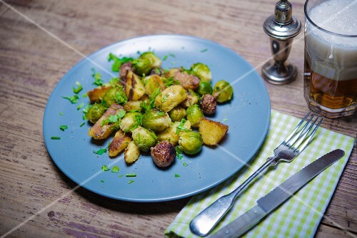 Fried potatoes with sausages and Brussels sprouts