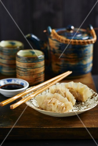 Gyoza with soy sauce served with tea