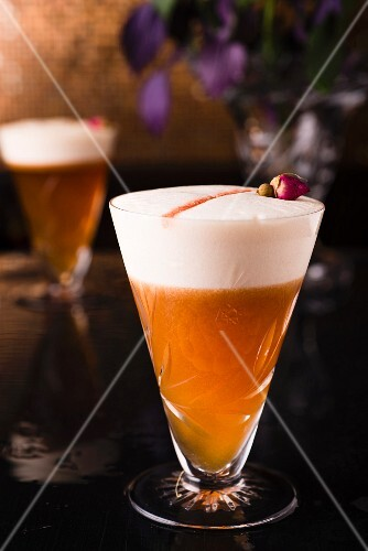 Pinot Noir Sour: a cocktail made with Pinot Noir syrup, grape juice and egg white