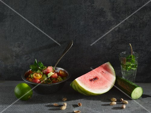 Tomato and melon salad with a mint and pistachio nut dressing