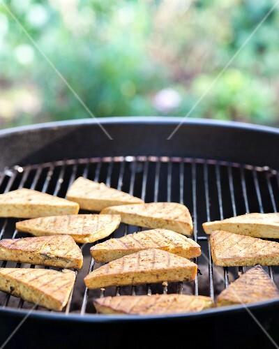 Smoked tofu on a barbecue
