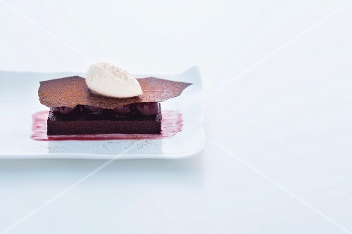 Warm chocolate tart with red wine pears and pear sorbet
