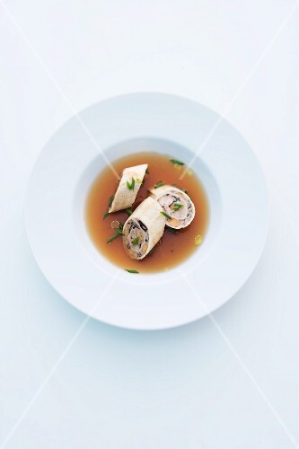 Venison consomme with mushrooms rolls
