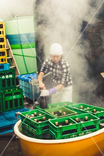 A workout with bottles of sake surrounded by steam
