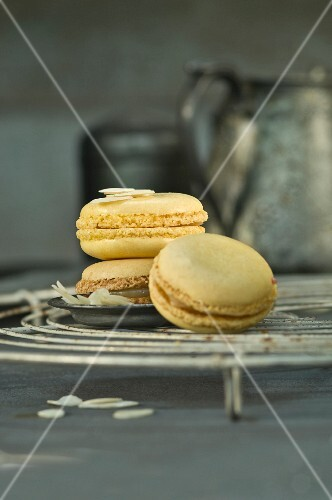 Lemon macaroons with flaked almonds on a wire rack