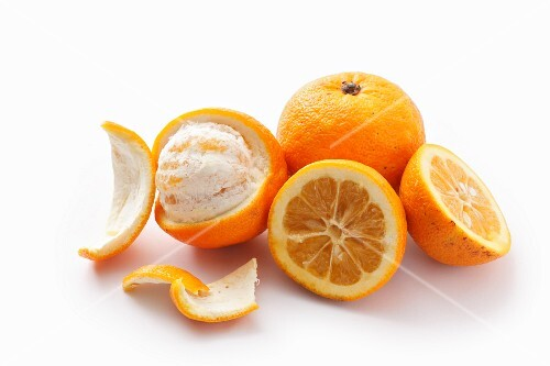 Bitter oranges, whole, halved and peeled