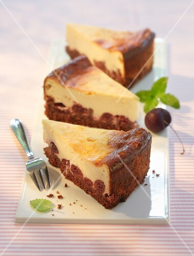 Three slices of chocolate and cherry cheesecake