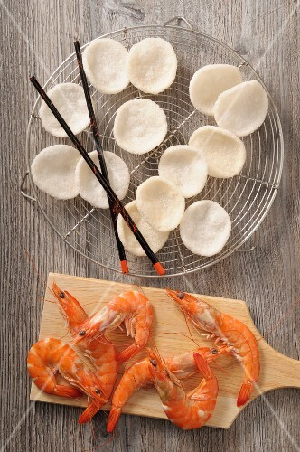 Prawn cocktails on a wire rack and prawns on a wooden board