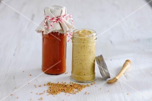 Jars of mustard and ketchup