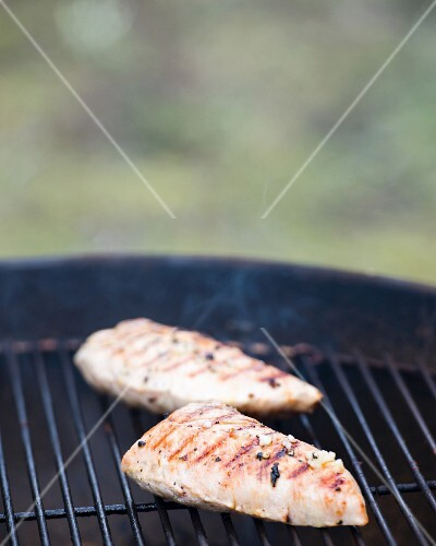 Turkey breast fillets on a barbecue
