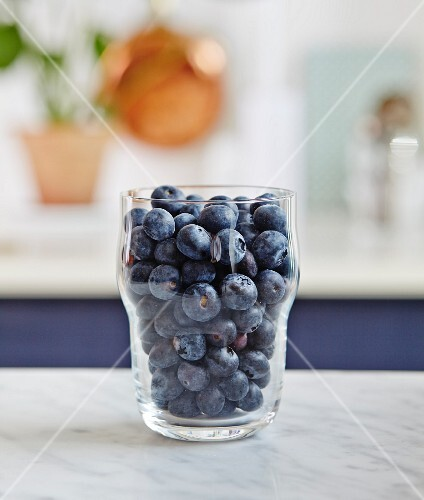A glass of fresh blueberries